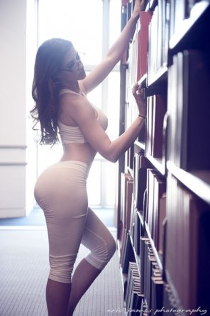 amateur photo Checking her out while she checks out the books