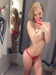 amateur photo Trying to find panties that match her phone case.
