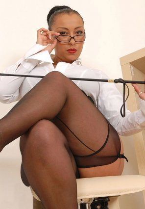 amateur photo Stern woman in seamed stockings