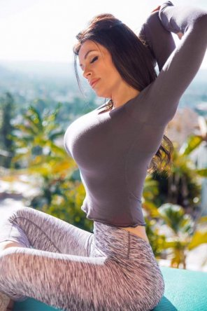 amateur photo Denise Milani stretching in the warm sun!