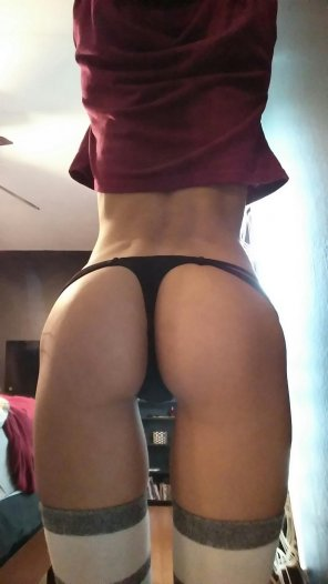 amateur photo Showing off her black thong