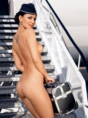 amateur photo Nude flight attendant is ready for her flight
