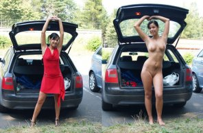 amateur photo Getting changed by her car