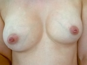 amateur photo Free at last from the dreadful bra and into the shower.