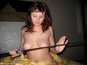amateur photo PictureTopless girl with sword.