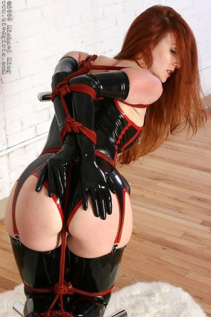 amateur photo Red hair red rope