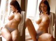 voluptuous redhead by the window