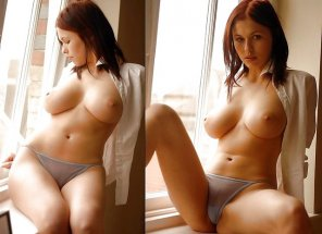 amateur photo voluptuous redhead by the window