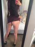 amateur photo posing in her brother's room