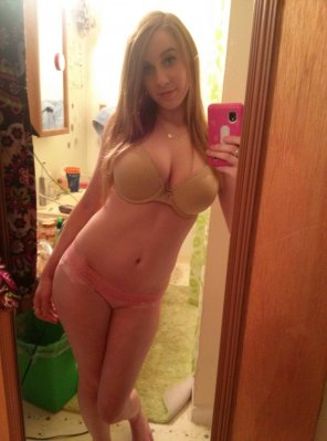 amateur photo Scantily clad young blonde woman