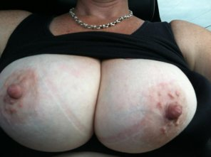 amateur photo #HotMom topless in the car.