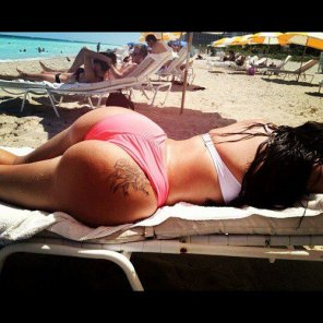 amateur photo Beautiful Brunette with Amazing Tattoo Booty Ass in the Beach.