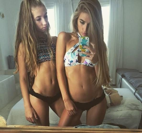 Sisters Porn Photo