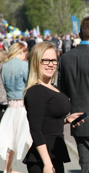 amateur photo Bespectacled busty blonde
