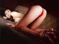 Very hot asian in fishnets, panties and high heels.