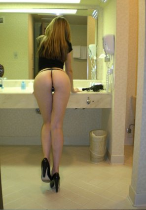 amateur photo Bent over the sink
