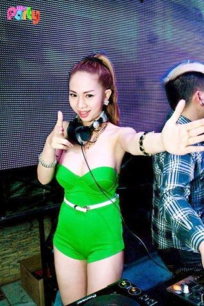 amateur photo DJ Tina Bee in tight green clothing