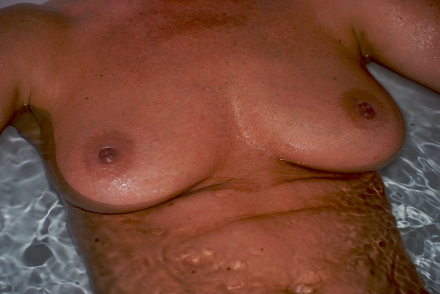 amateur photo Topless sunbathing by my wife leads to tanned tits in the tub