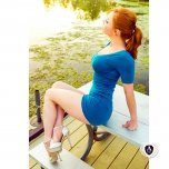 amateur photo Redhead by the water