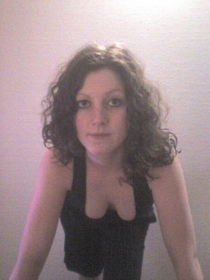 amateur photo Curly brunette downblouse
