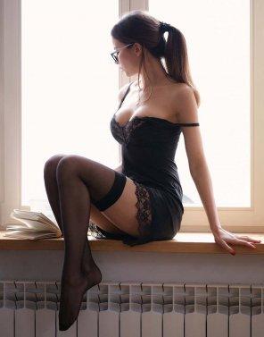 amateur photo Sitting on the window ledge