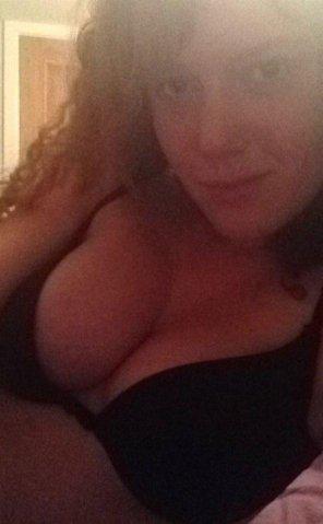 amateur photo PictureAmateur redhead showing off her bra