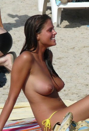 amateur photo Not her first day on the topless beach.