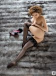 amateur photo Gorgeous woman in black stockings on a fur blanket