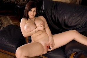 amateur photo Karina Hart playing on the couch