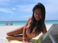 amateur photo Cute girl enjoying some sun and fun on the beach