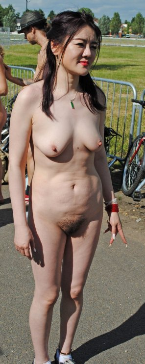 amateur photo Asian woman at the naked bike ride