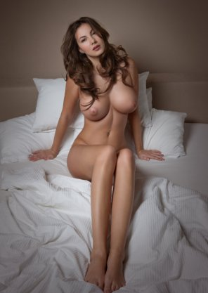 amateur photo Stunning brunette sitting on her bed
