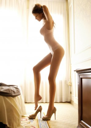amateur photo Putting on her high heels