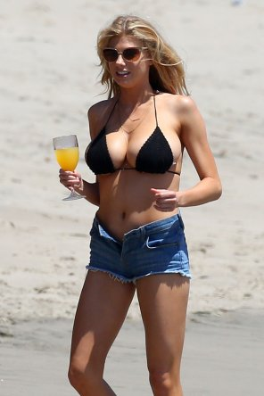 amateur photo Charlotte McKinney at the beach in denim shorts