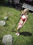 amateur photo Finnish Girl doing some yard work.