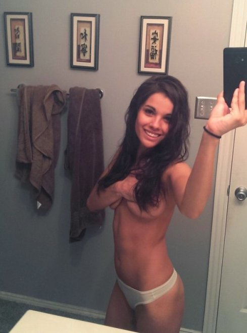 Pretty girl with a selfie in the bathroom. Porn Photo