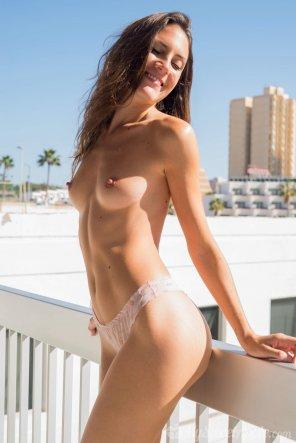 amateur photo Cute brunette in a hotel balcony