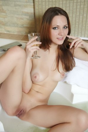 amateur photo Having some wine while the tub fills up