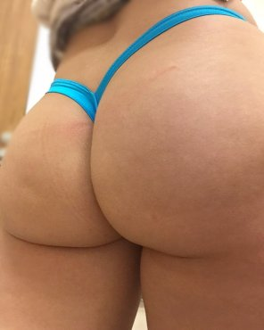 amateur photo [F] Thong of the day!!! I think this one might be the most popular! My turquoise V-Back thong 🍑