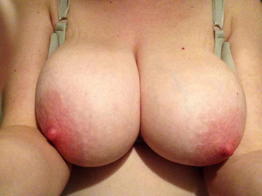 PictureTaking off the bra. Porn Photo