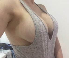 amateur photo Pulling her top down