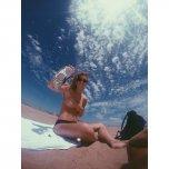 amateur photo Topless teen on the beach