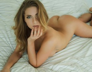 amateur photo Naked on the bed.