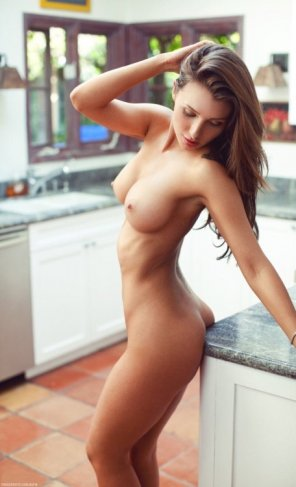 amateur photo Ass against kitchen counter