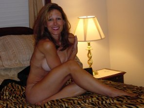 amateur photo Slightly shy MILF on the bed