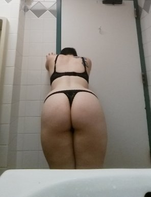 amateur photo BF told me to wear a thong to work and take a picture for him and Reddit in the bathroom. I felt so naughty and sexy!