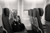 amateur photo Exposing her tits on an empty airplane