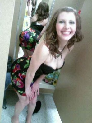 amateur photo Busty brunette in a dressing room