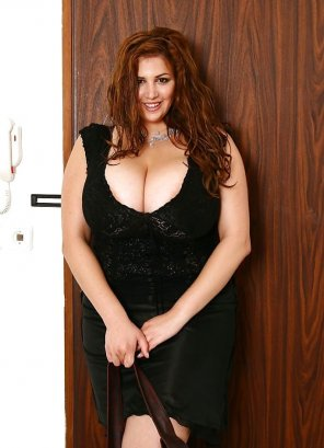 amateur photo Eden Mor is positively packed into her tight black dress