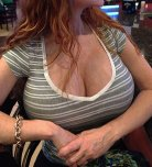 amateur photo Girl in a bar with amazing tits.